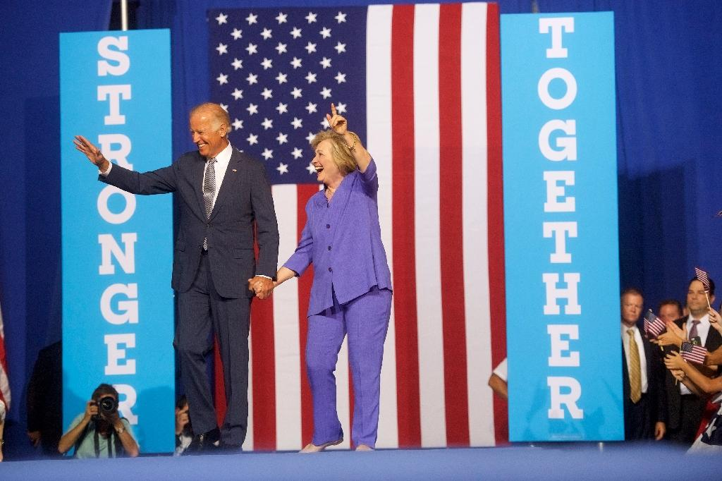 Democratic presidential nominee Hillary Clinton and US Vice President Joe Biden campaign in August 2016 (AFP Photo/Mark Makela)