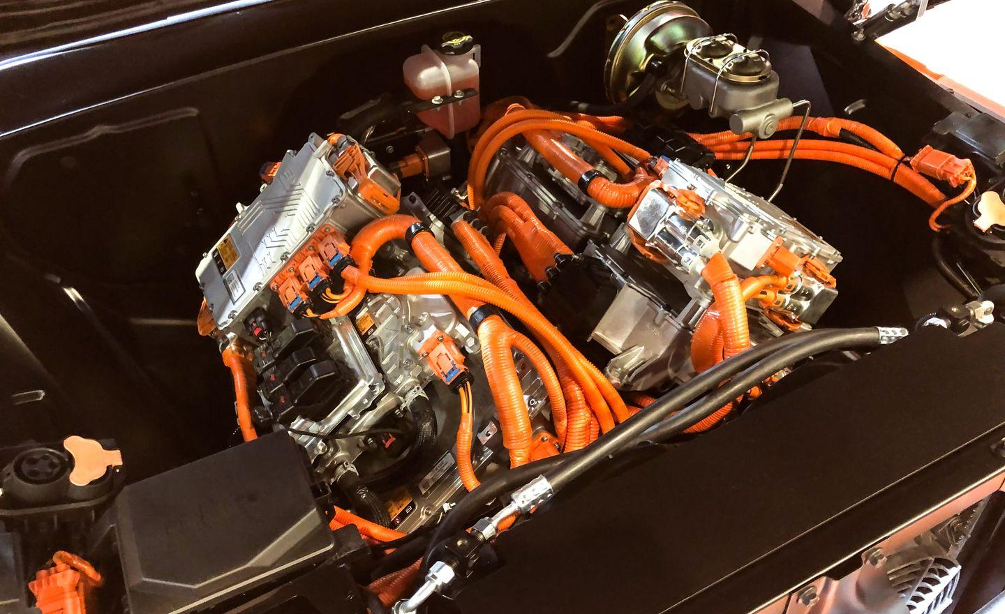 """<p>It's not an engine, it's a motor. Get it right. The <a href=""""https://www.caranddriver.com/news/a29714391/chevy-e-10-pickup-sema/"""" rel=""""nofollow noopener"""" target=""""_blank"""" data-ylk=""""slk:Chevrolet E-10 concept"""" class=""""link rapid-noclick-resp"""">Chevrolet E-10 concept</a> is a 450-hp electrified C-10 pickup. Typically the only time a 1970s Chevy pickup is plugged into anything, it's getting a two-amp charge in a barn someplace. In the E-10's case, however, the battery isn't on the workbench; it's inside the bed. The two electric motors seen here are called eCrate motors, a nod to the popular Chevy crate engines that <a href=""""https://www.caranddriver.com/reviews/a15097317/flyin-miata-habu-mx-5-v-8-test-review/"""" rel=""""nofollow noopener"""" target=""""_blank"""" data-ylk=""""slk:can be found swapped into just about anything"""" class=""""link rapid-noclick-resp"""">can be found swapped into just about anything</a>. GM claims the E-10 can complete a zero-to-60-mph takeoff in roughly five seconds with a quarter-mile time in the high 13s. A Tesla P100D can do it in 10.72 seconds, but it doesn't look as cool. We'd like to imagine this setup offered in a 2021 Chevrolet Bolt SS, but we know better. </p>"""