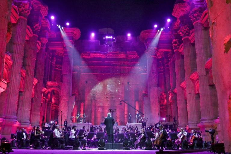Maestro Harout Fazlian conducts rehearsals ahead of the Sound of Resilience concert inside the Temple of Bacchus at the historic site of Baalbek in Lebanon's eastern Bekaa Valley (AFP Photo/-)