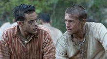 Charlie Hunnan e Rami Malek planejam fuga espetacular no trailer do remake de 'Papillon'. Assista