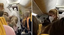 Terrified passengers watch as man with coronavirus escorted off flight