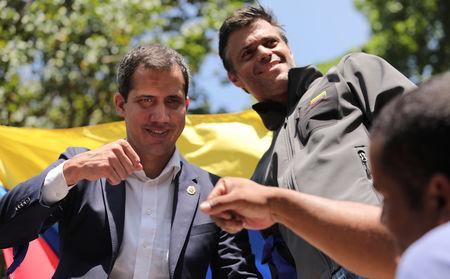 Venezuelan opposition leaders Guaido and Lopez address supporters in Caracas