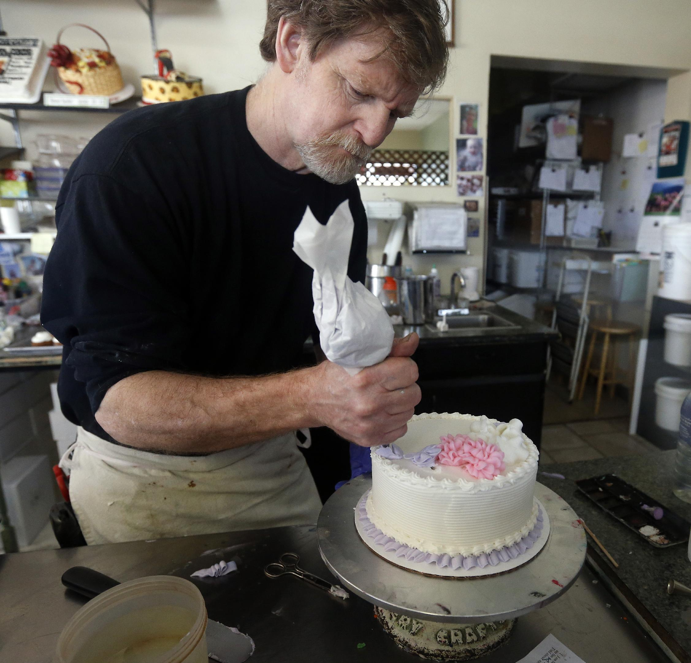 In this March 10, 2014 photo, Masterpiece Cakeshop owner Jack Phillips decorates a cake inside his store, in Lakewood, Colo. Phillips is appealing a recent ruling against him in a legal complaint filed with the Colorado Civil Rights Commission by a gay couple he refused to make a wedding cake for, based on his religious beliefs. (AP Photo/Brennan Linsley)