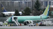 Boeing posts shock loss as 737 MAX crisis grows, but stock rises