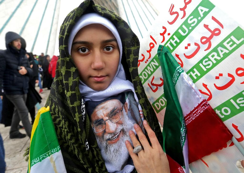 An Iranian girl holds a potrait of the country's Supreme Leader Ali Khamenei during a ceremony celebrating the 40th anniversary of the Islamic revolution in Tehran on February 11, 2019 (AFP Photo/ATTA KENARE)