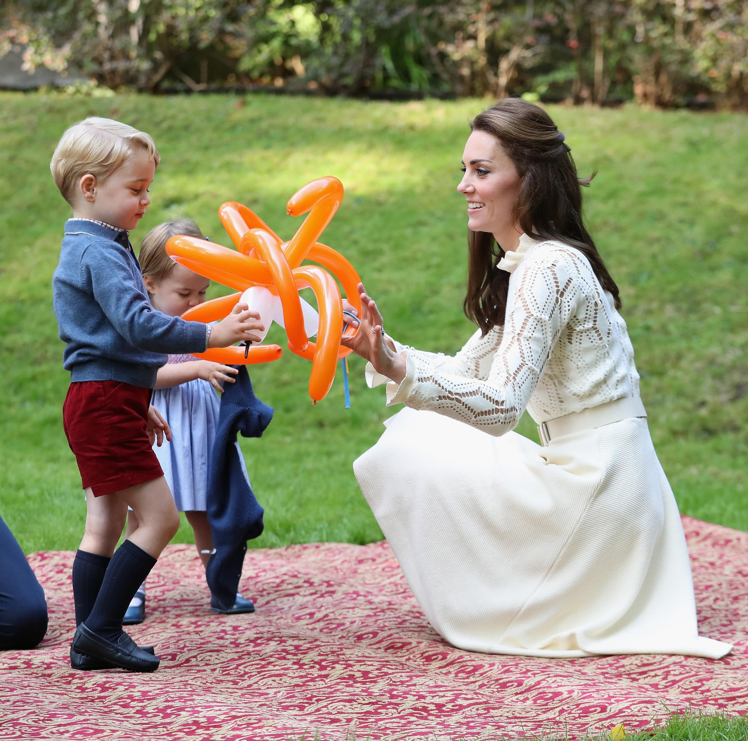 File photo dated 29/09/16 of the Duchess of Cambridge with her children Prince George and Princess Charlotte at a children's party for Military families at Government House in Victoria during the Royal Tour of Canada.