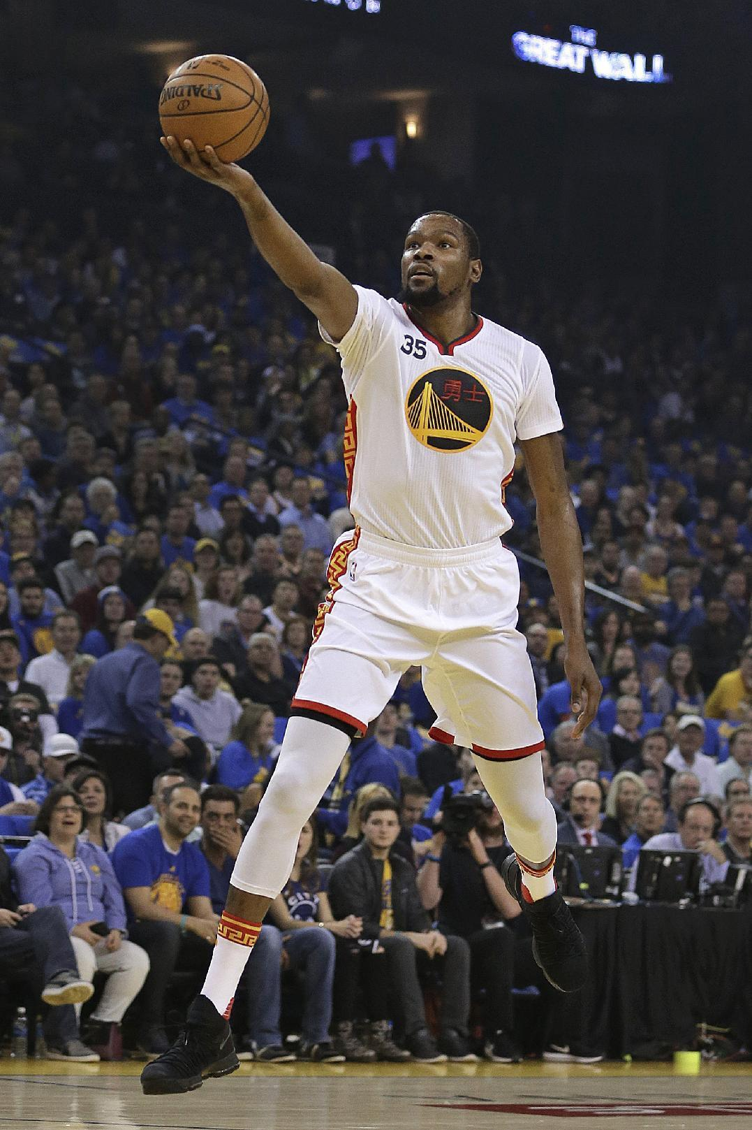 Durant, Thompson help Warriors bounce back, beat Bulls