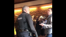Footage of two black men handcuffed in Starbucks prompts police investigation