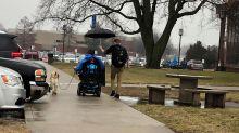 'Umbrella guy, thank you': Internet praises man shielding student in a wheelchair from rain