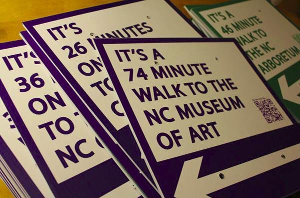 Student's push to make Raleigh more walkable relies on homemade signs and QR codes