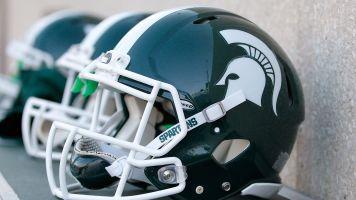 Ex-employee sues Michigan State coach