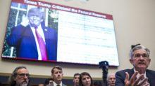 Nasdaq ends at record, dollar falls as US Fed signals possible rate cut