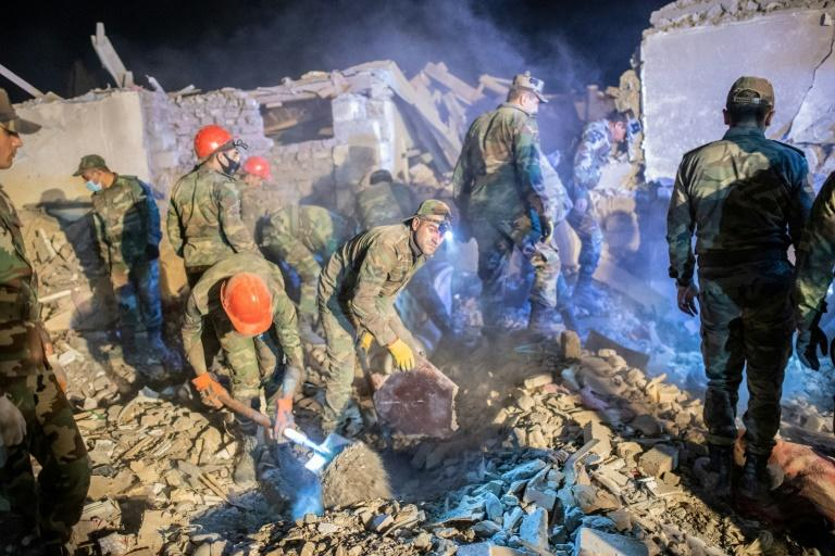 Rescue teams sift through rubble of a missile Azerbaijan's Ganja, which marks a dramatic broadening of the Nagorno-Karabakh conflict