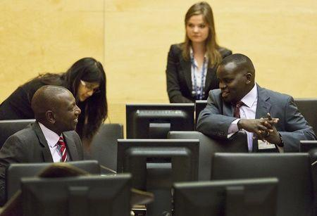 Kenya's Deputy President William Ruto speaks with broadcaster Joshua arap Sang (R) in the courtroom before their trial at the International Criminal Court (ICC) in The Hague in this September 10, 2013 file photo. REUTERS/Michael Kooren/Files