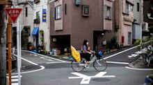 Japan cyclist becomes first to face dangerous driving charges after law change to include bikes