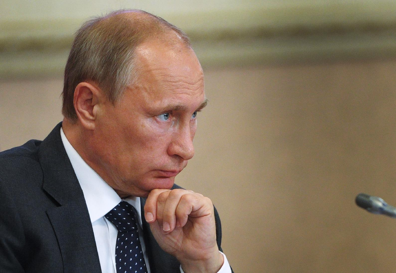 Russian President Vladimir Putin attends a local administration meeting as he visits Voronezh on August 5, 2014