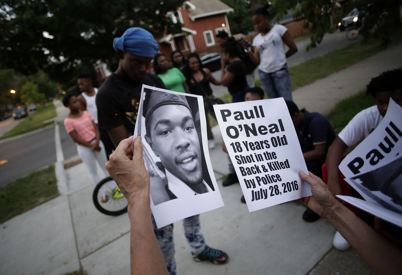 <p>Demonstrators distribute photos of Paul O'Neal before protesting his fatal shooting by a Chicago police officer August 5, 2016 in Chicago, Illinois. (Photo: Joshua Lott/Getty Images)</p>
