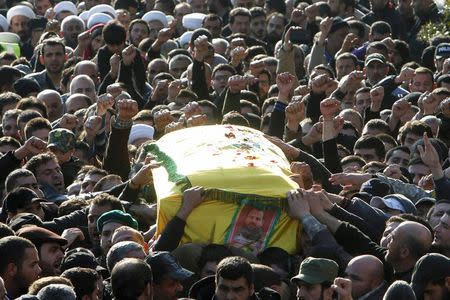 Hezbollah members and supporters carry the coffin of Lebanon's Hezbollah commander Mohamad Issa, known as Abu Issa, during funeral in Arab-Salim, south Lebanon