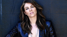 Elizabeth Hurley, 54, strips down for racy Christmas message: 'Sexiest woman ever'