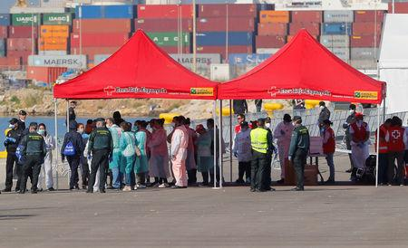 Boat migrants rocked by EU political storm arrive in Spain
