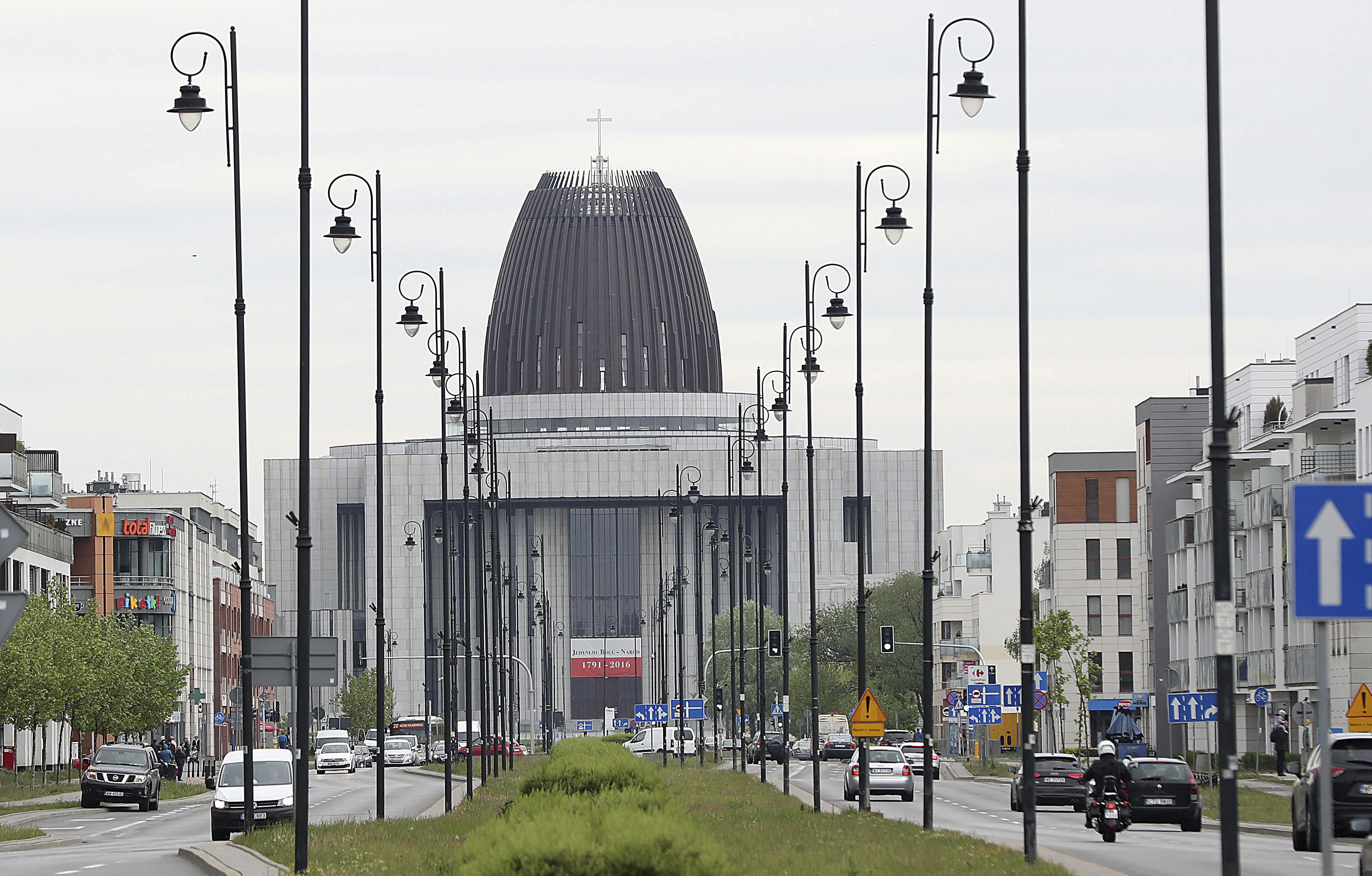 Cars drive on the street in front of the Temple of Divine Providence, a major church in the Polish capital, in Warsaw, Poland, Monday, May 13, 2019. A new documentary about pedophile priests has deeply shaken Poland, one of Europe's most Roman Catholic societies, eliciting an apology from the church hierarchy and prompting one priest to leave the clergy.(AP Photo/Czarek Sokolowski)