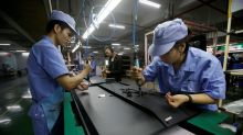 China's November industrial output, retail sales beat expectations