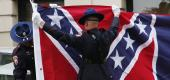 A Mississippi Highway Safety Patrol honor guard folds the retired Mississippi state flag. (AP)