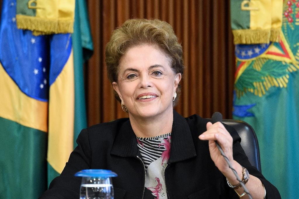 Brazilian President Dilma Rousseff, deeply unpopular because of a giant corruption scandal centered on state oil company Petrobras and her management of the country's worst recession in decades, faces impeachment in Congress (AFP Photo/Evaristo Sa)