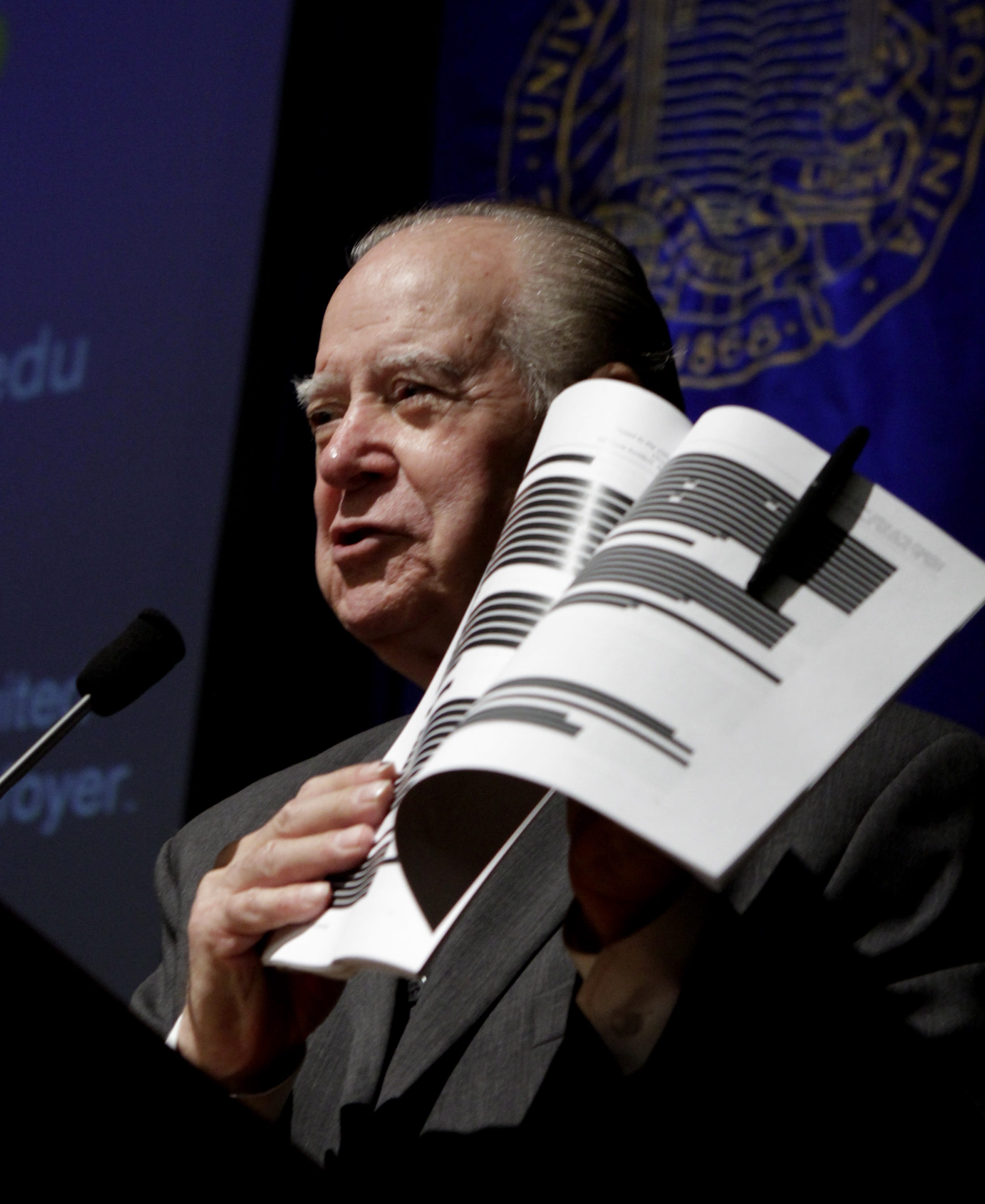 Retired California Supreme Court Justice Cruz Reynoso, who led a 13 member task force looking into the pepper spraying incident that occurred at the University of California, Davis last November, holds up an early copy of the report during a town hall style meeting held at the campus in Davis, Calif., Wednesday, April 11, 2012. The report was originally set for release March 6, but lawyers for the law enforcement officers involved wanted more than 60 percent of the document blacked out claiming it contained personnel records that should not be publicly released under state law. The final report was released with much of the information reinstated but without the names of most of the officers involved in the clash. (AP Photo/Rich Pedroncelli)