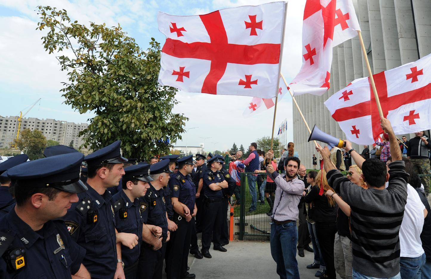 Supporters of Mikhail Saakashvili's United National Movement rally outside the party's headquarters in Tbilisi, Georgia on October 15, 2014