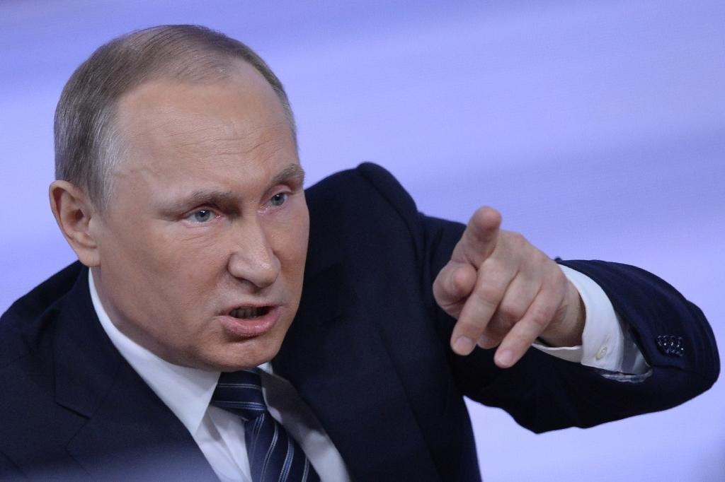 Russian President Vladimir Putin fired off an angry tirade against Turkey on December 17, ruling out any reconciliation with its leaders and accusing Ankara of shooting down a Russian warplane to impress the US (AFP Photo/Natalia Kolesnikova)
