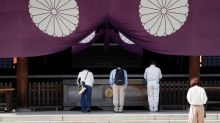 Former Japan PM Abe visits Yasukuni Shrine for war dead
