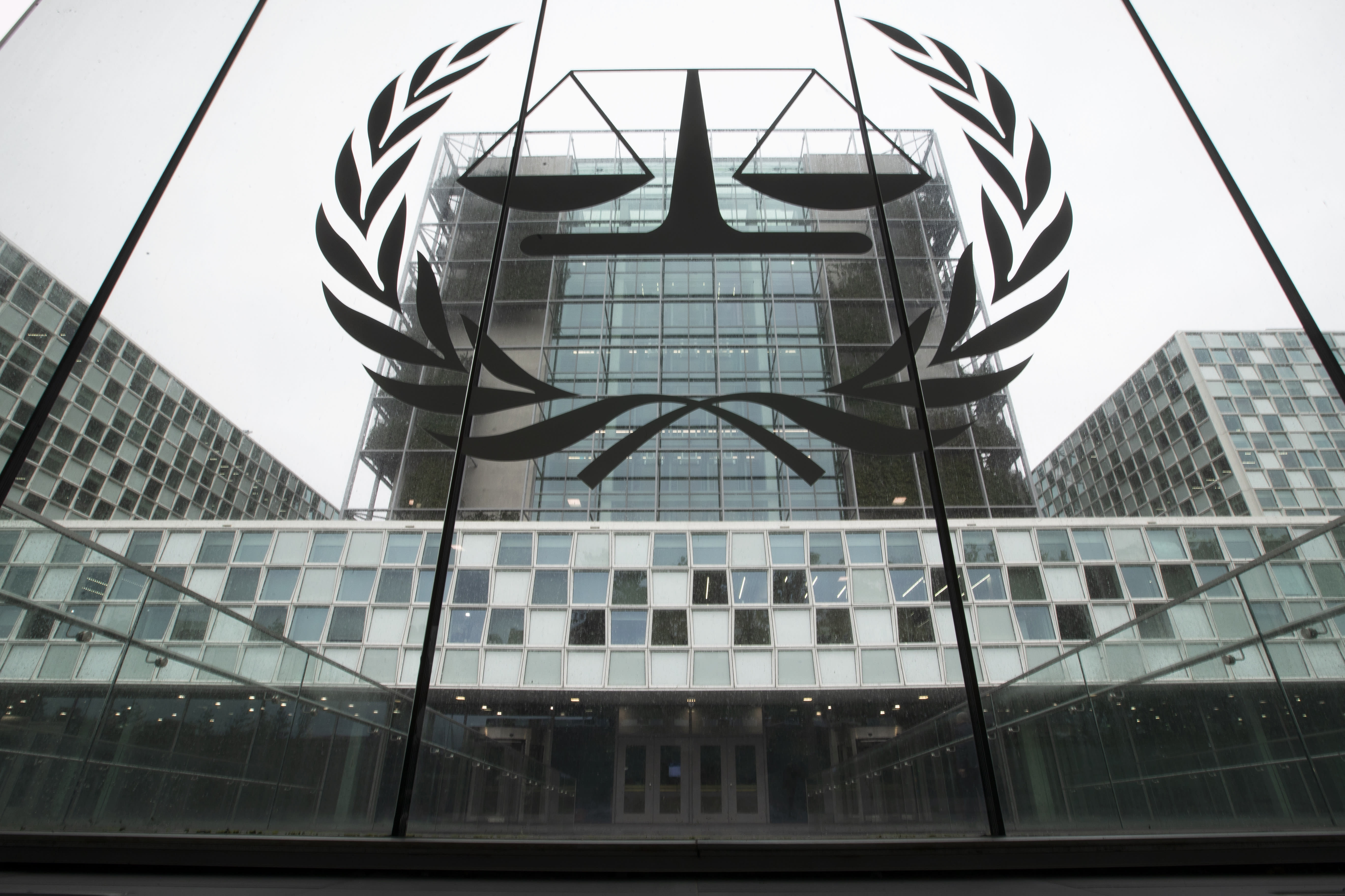 -FILE- In this Thursday, Nov. 7, 2019 file image the International Criminal Court, or ICC, is seen in The Hague, Netherlands. Sudanese militia leader Ali Kushayb has been arrested on war crimes charges related to the conflict in Darfur more than 13 years after a warrant was issued for him, authorities said Tuesday. Kushayb surrended to authorities in a remote corner of northern Central African Republic, near the country's border with Sudan, International Criminal Court spokesman Fadi El Abdallah said. (AP Photo/Peter Dejong, File)
