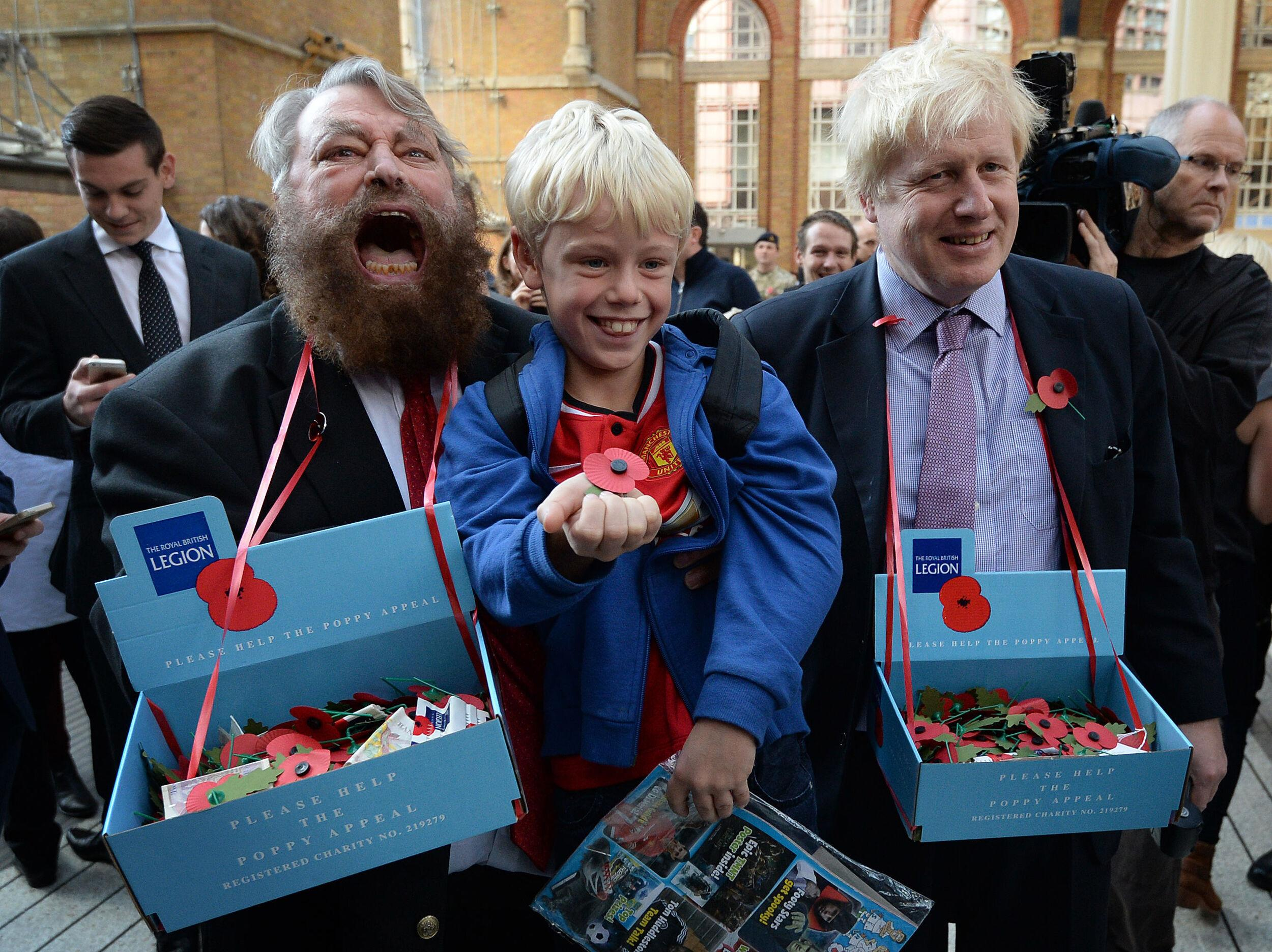 Actor Brian Blessed (left) and Mayor of London Boris Johnson sell poppies in Liverpool Street Station in central London with they collected money from commuters including nine year old Arthur Crowley (centre) from Salisbury.