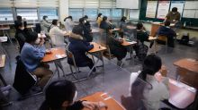 Asia Today: S. Korean students take exams amid viral spike