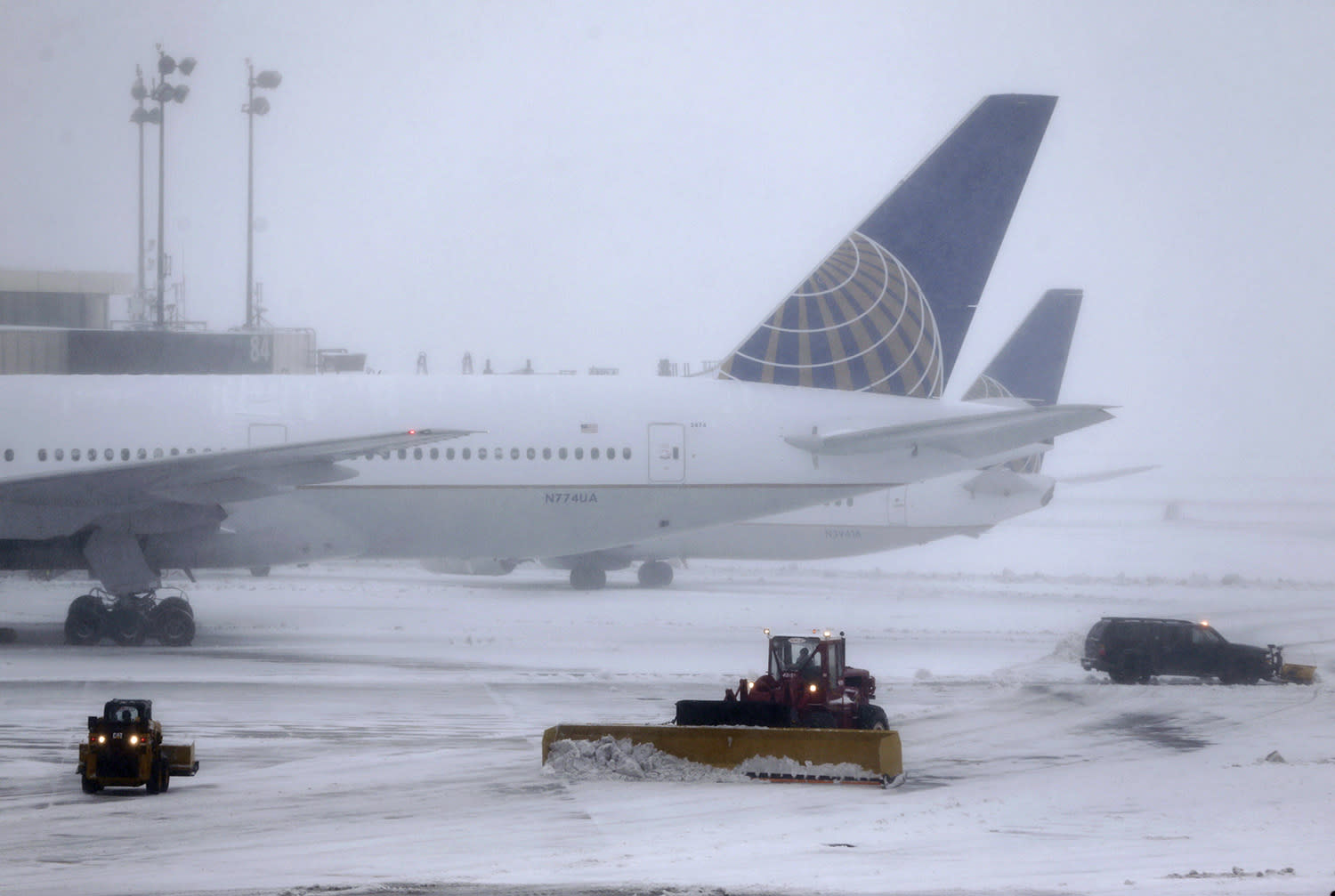 <p>Snowplows work to keep the grounds clear at Newark Liberty International Airport in Newark, N.J., Tuesday, March 14, 2017. A storm pounded the Northeast with more than a foot of snow in places Tuesday, paralyzing much of the Washington-to-Boston corridor after a remarkably mild February had lulled people into thinking the worst of winter was over. (Seth Wenig/AP) </p>
