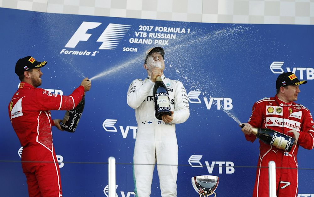 Valtteri Bottas (centre) celebrates his first Grand Prix win with Sebastian Vettel (left) and Kimi Raikkonen (right) - Rex Features