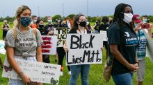 In Parkland, one side of the street chanted 'Black Lives Matter.' The other, 'U.S.A.'