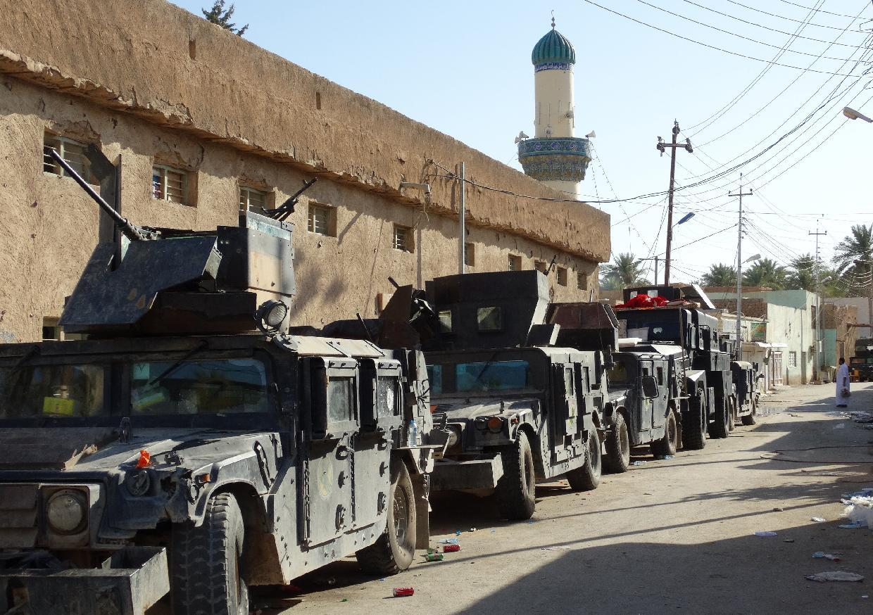 Iraqi army vehicles are seen on September 10, 2014 in Barwanah in the Anbar province (AFP Photo/Azhar Shallal)