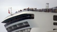 Rejected by Jamaica, Caymans over virus fears, cruise ship docks in Mexico