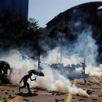 Hong Kong protesters fire bows and arrows from campus fortress