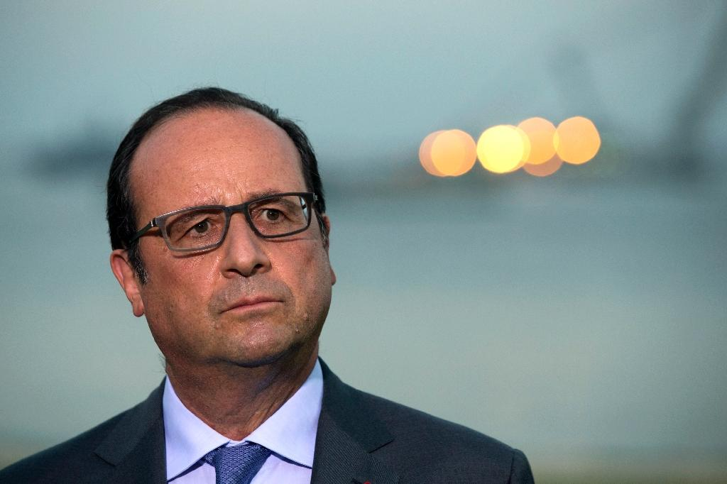 French President Francois Hollande listens to questions after he delivered a speech in front of the Suez Canal in Ismailia, Egypt, on August 6, 2015 (AFP Photo/Philippe Wojazer)