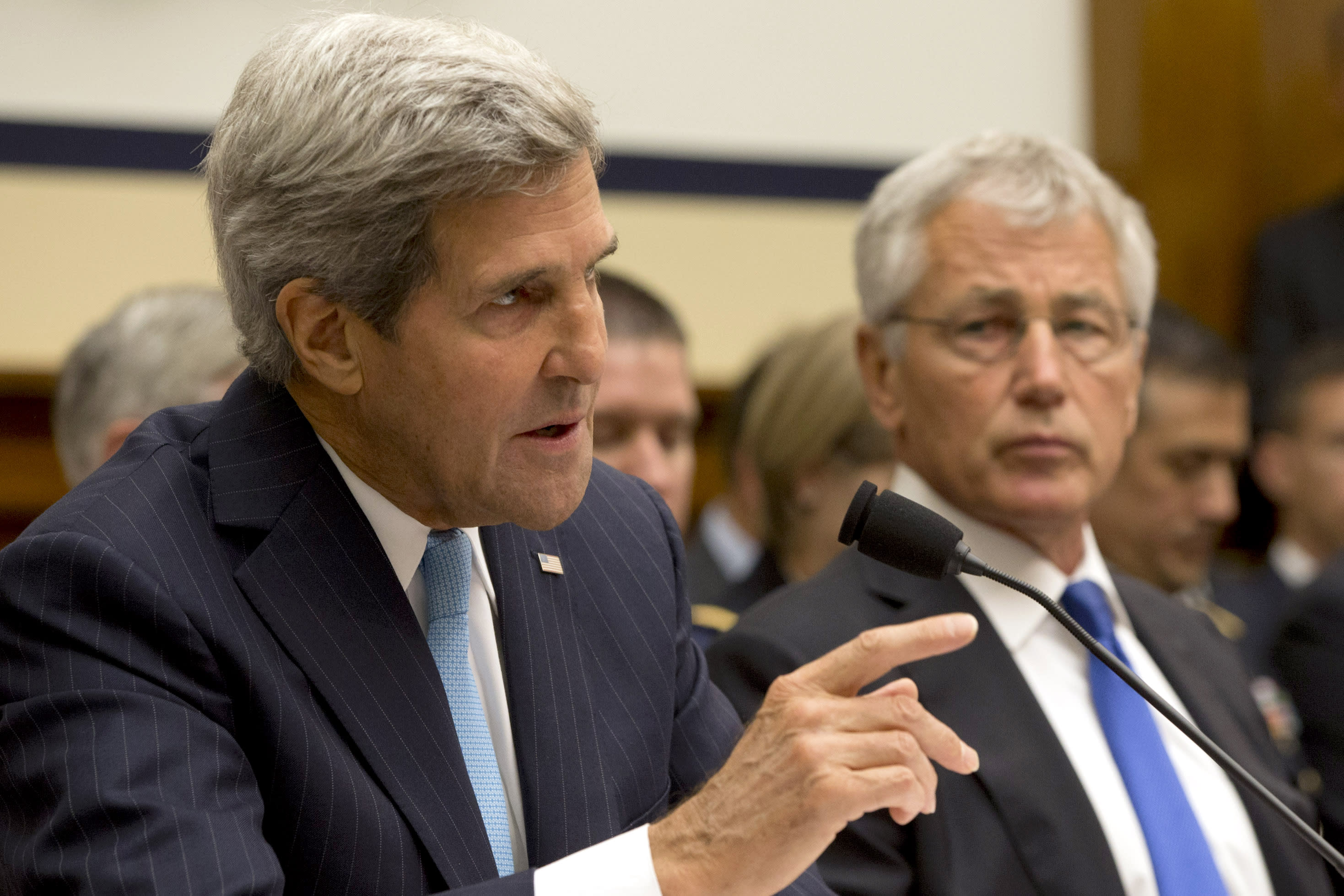 Defense Secretary Chuck Hagel listens at right as Secretary of State John Kerry testifies on Capitol Hill in Washington, Tuesday, Sept. 10, 2013, before the House Armed Services Committee hearing on the proposed authorization to use military force in Syria. (AP Photo/Jacquelyn Martin)