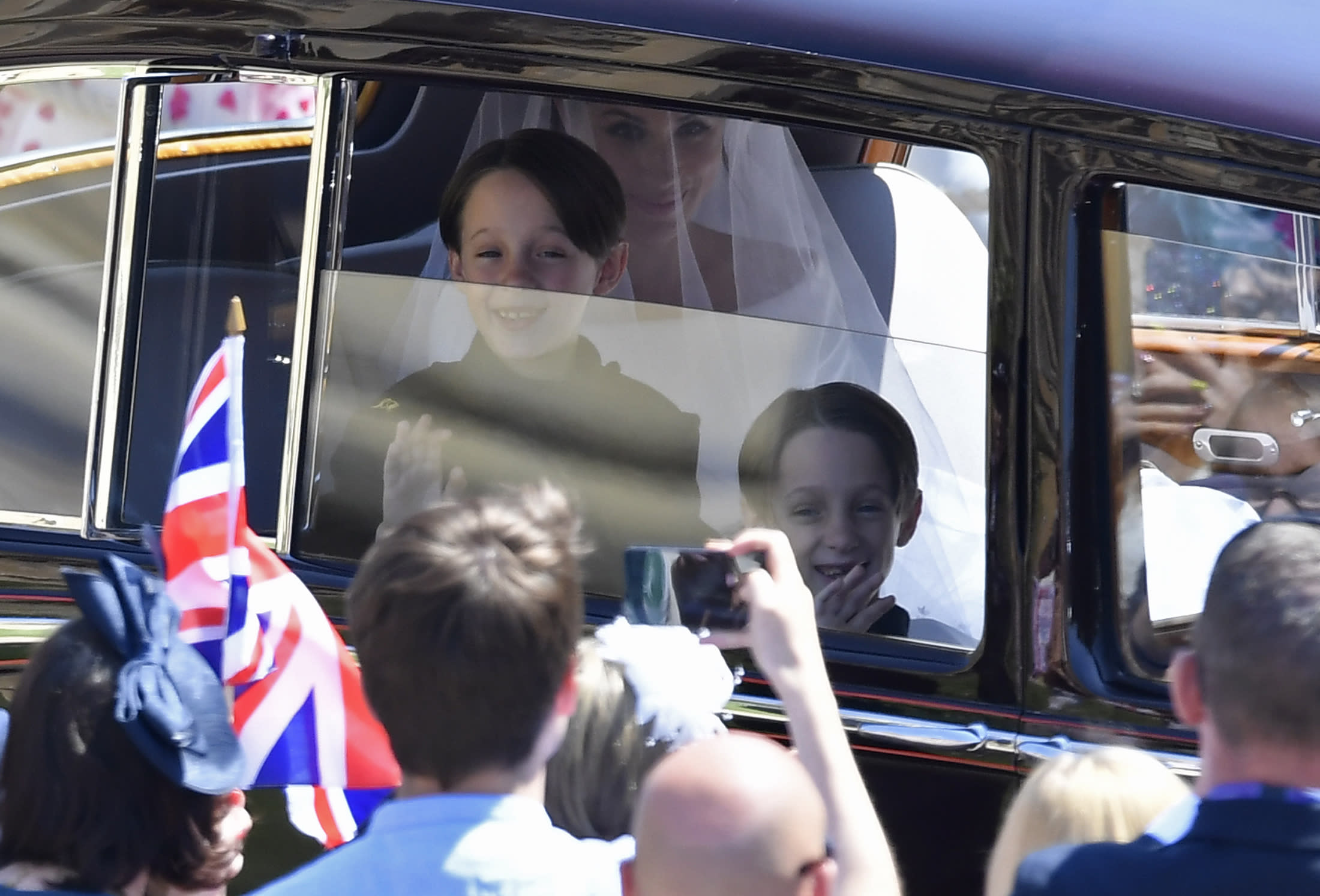 <p>Meghan Markle is driven to St George's Chapel in Windsor Castle along with her page boys Brian and John Mulroney at St George's Chapel at Windsor Castle before the wedding of Prince Harry to Meghan Markle on May 19, 2018 in Windsor, England.</p>  <p>(Photo by Toby Melville- WPA Pool/Getty Images)</p>