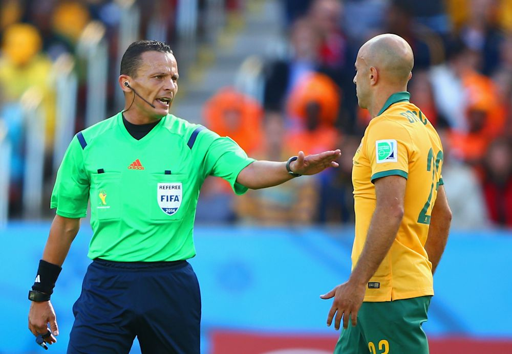 Referee Djamel Haimoudi speaks to Mark Bresciano of Australia. (Getty Images)
