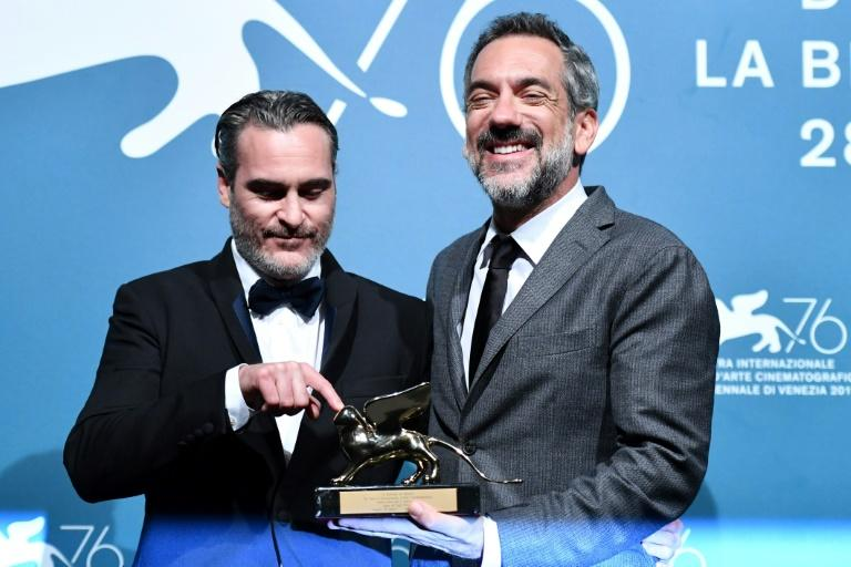 US director Todd Phillips (r) flanked by Joaquin Phoenix whom he described as 'the fiercest and the bravest' actor (AFP Photo/Alberto PIZZOLI)