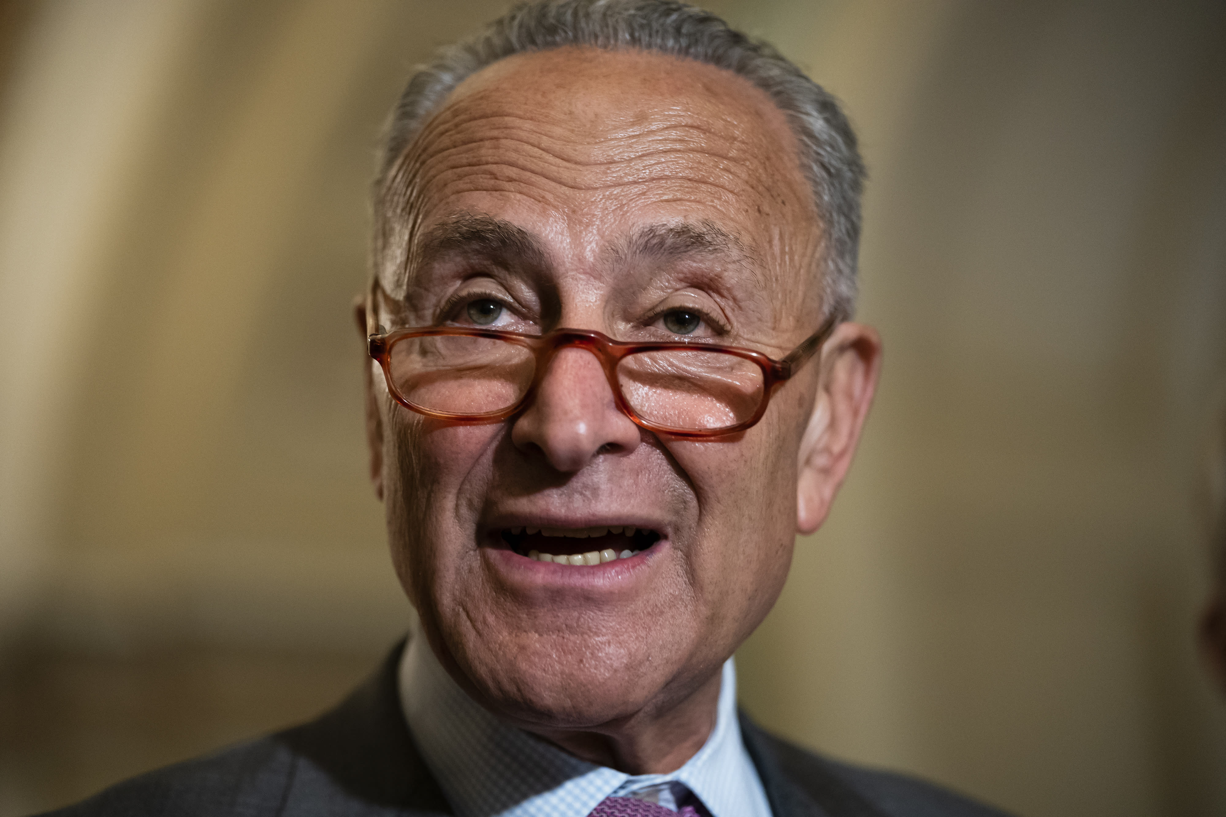 Senate Minority Leader Chuck Schumer, D-N.Y., condemns remarks by President Donald Trump as he speaks to reporters following a Democratic policy meeting, at the Capitol in Washington, Tuesday, July 16, 2019. (AP Photo/J. Scott Applewhite)
