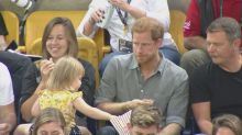 Prince Harry catches toddler stealing his popcorn in adorable scenes at Invictus Games