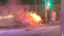 Couple pull strangers from vehicle moments before it bursts into flames, saving their lives