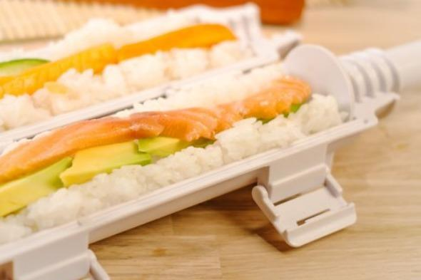"""<p>Have you ever wondered who these people are with the time and patience to make their own sushi? Well now you can be one of them - but without the time and patience - because the sushi bazooka will make it for you.</p>  <p>Just load the gun with the rice and top with your filling, then seal it and squeeze. The sushi gun will then fire out a perfectly formed sushi roll. Your eating habits will be transformed for just £19.99 from <a href=""""http://www.firebox.com/product/6476/The-Sushi-Bazooka"""" target=""""_blank"""">Firebox.com</a></p>"""